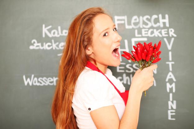Teambuilding-Kochkurs Hamburg - Frau mit roten Haaren
